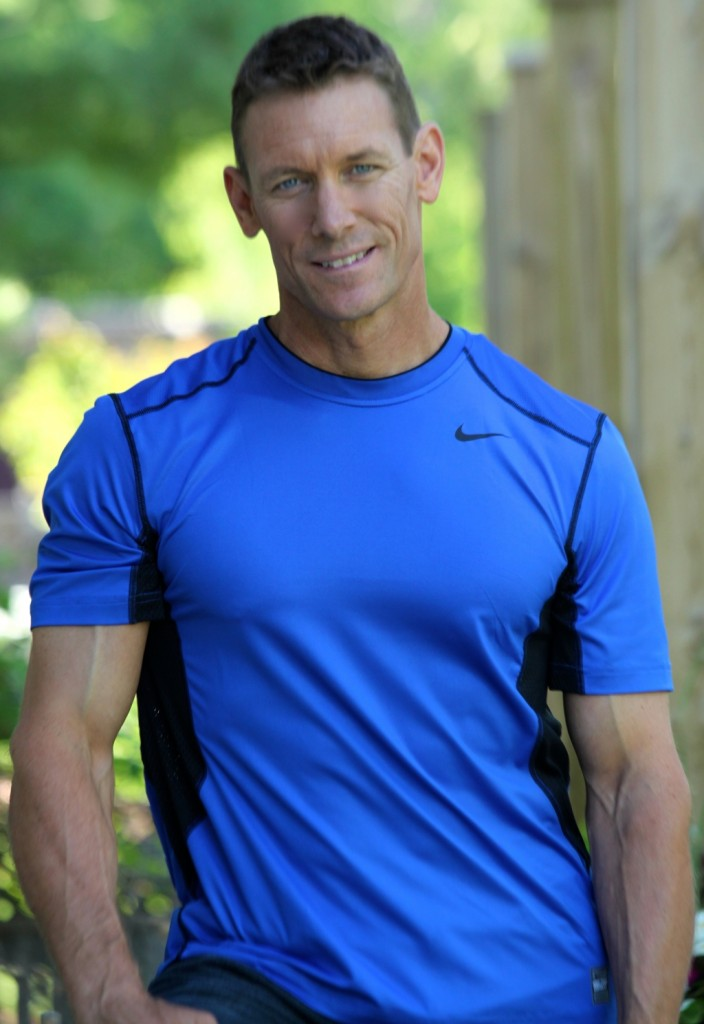 Photo of a man in a blue athletic shirt.