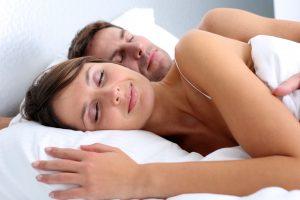 A man and woman sleeping.